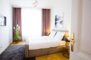 Säng eller sängar i ett rum på The Flats Apartments - Naschmarkt