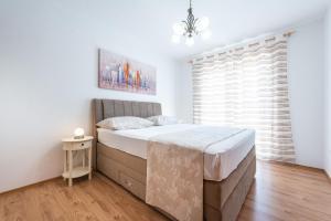 Un ou plusieurs lits dans un hébergement de l'établissement Penthouse Leon