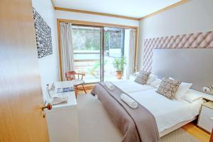 Ліжко або ліжка в номері Quinta Miramar