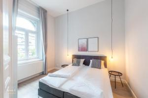 A bed or beds in a room at Liv Residence