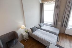 Ένα ή περισσότερα κρεβάτια σε δωμάτιο στο eLoftHotel