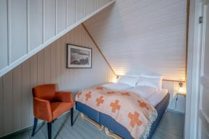 En eller flere senger på et rom på Nyvågar Rorbuhotell - By Classic Norway Hotels