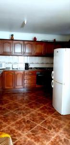 A kitchen or kitchenette at The Dream Apartament