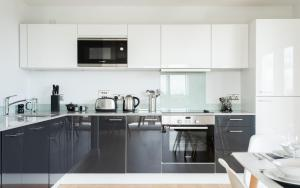 A kitchen or kitchenette at 2 Bedroom 2 Bathroom Apartment with large balcony