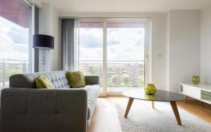 A seating area at 2 Bedroom 2 Bathroom Apartment with large balcony