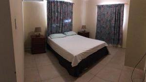 A bed or beds in a room at Mahuma Apartments