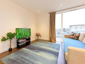 A television and/or entertainment center at Grand Apartments - Kew Gardens