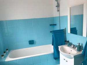 A bathroom at Old Town Central Apartment