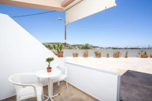 A balcony or terrace at Savviou Rooms