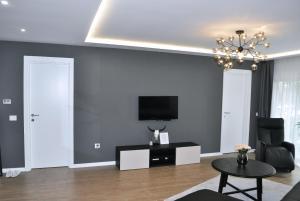 TV i/ili multimedijalni sistem u objektu Unique Center Apartment