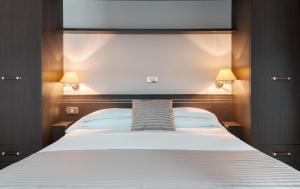 Ein Bett oder Betten in einem Zimmer der Unterkunft Loano 2 Village