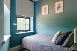 A bed or beds in a room at RUBY Guest Accommodation