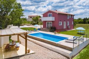 The swimming pool at or near Villa May