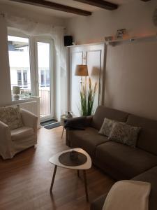 Ein Sitzbereich in der Unterkunft Haus Solymar App. Meerblick