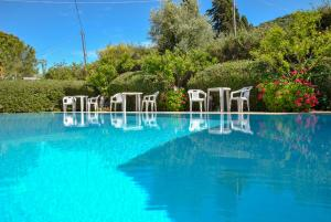The swimming pool at or near Stefanos Studios