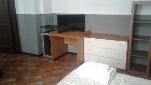 A television and/or entertainment center at Politi Aparthotel