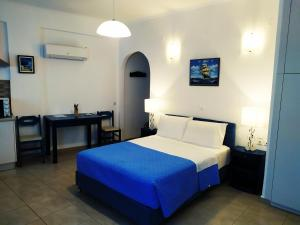 A bed or beds in a room at Phoenix