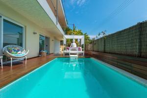 The swimming pool at or near Destino Royal Beach