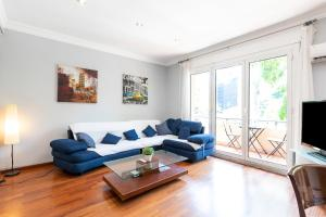 A seating area at Gracia Apartment