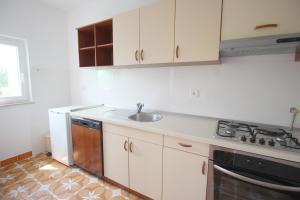 A kitchen or kitchenette at Casa Lidija