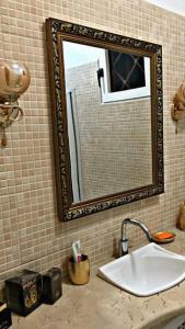 A bathroom at Penthouse: La NeNa
