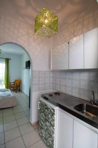 A kitchen or kitchenette at Bella Casa Studios