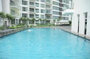 The swimming pool at or near Amazing Suites at Regalia KLCC