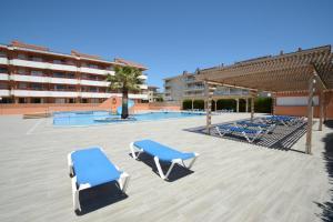 The swimming pool at or near Apartamentos familiares Sa Gavina Gaudí