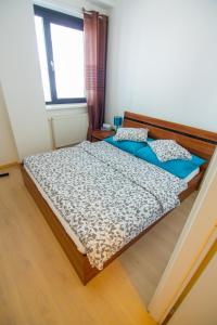 A bed or beds in a room at Bratislava Downtown Apartments