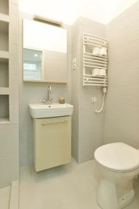 A bathroom at city center designer apartment in Eclectic building