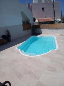 The swimming pool at or near Lazaros Home