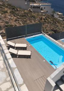 A view of the pool at Elena Village or nearby