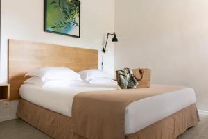 Un ou plusieurs lits dans un hébergement de l'établissement Résidence Santa Giulia Palace