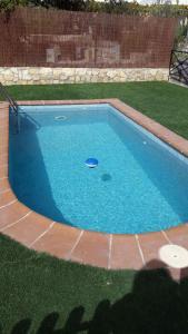 The swimming pool at or near Villa Palmera