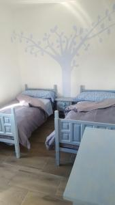 A bed or beds in a room at Villa Palmera