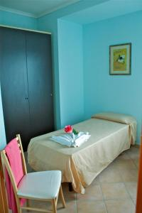 A bed or beds in a room at Residence Sol Levante