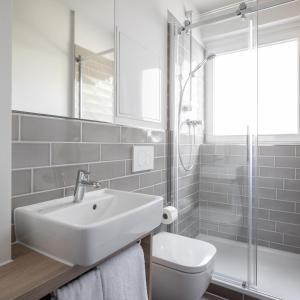Ein Badezimmer in der Unterkunft HUB-Apartments