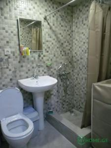 A bathroom at Apartment Kutaisi L&l