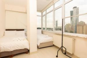 A bed or beds in a room at Huge Family Apartment Near Cevahir Mall