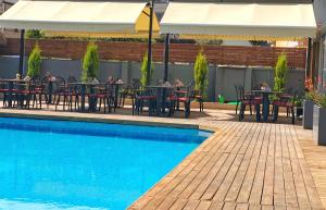 The swimming pool at or near HMA Hotel & Suites