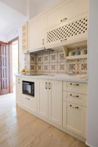 A kitchen or kitchenette at Kamares House Apartments & Studios