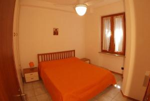 A bed or beds in a room at Primavera Bardolino