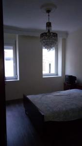 A bed or beds in a room at Οικία κοντά στη θάλασσα