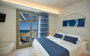 A bed or beds in a room at Sunrise Pelion Sea View Villas