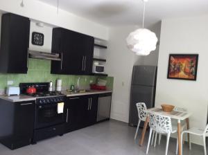 A kitchen or kitchenette at Beach Front Infiniti Blu Condo