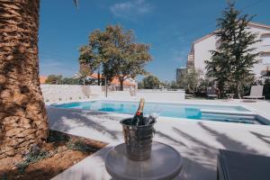 The swimming pool at or near Pool Apartments Galeb