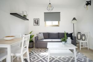 A seating area at YARKON - By Beach Apartments TLV