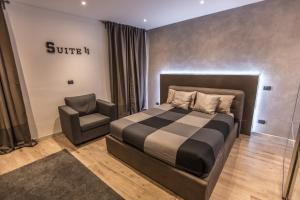 A bed or beds in a room at SUITE 11 NEAR DUOMO