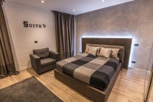 尼爾多莫11號套房公寓房間的床