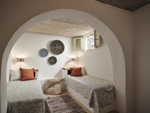 Letto o letti in una camera di Koufonisi Villas